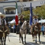 men on horses with flags during the parade