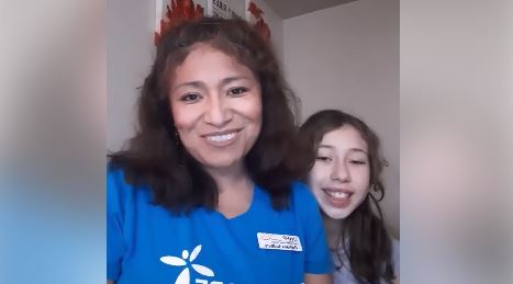 screenshot of Dahana's intro video with her and her daughter smiling